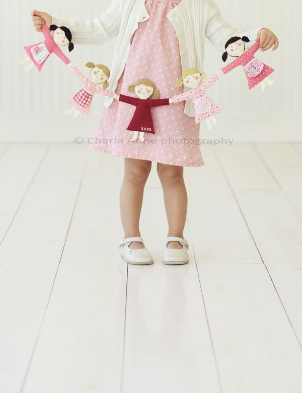 so darling. paper chain dolls made from fabric