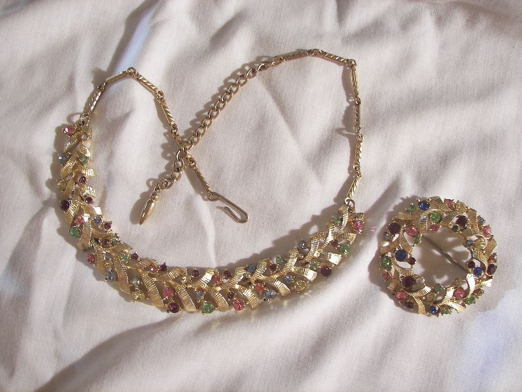 Always something exciting in store many items on sale from 10 to 60% off Beautiful Vintage Demi Pastel colored rhinestone Necklace and Brooch marked coro pat pend