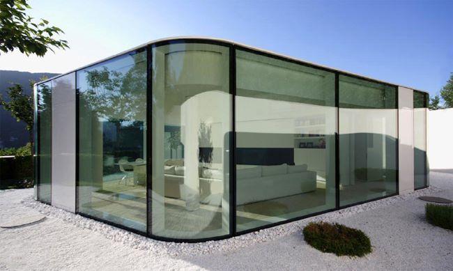 Between the Swiss Alps and Lake Lugano, architect Jacopo Mascheroni creates a rounded glass pavilion atop a submerged base - Brusino Arsizio, Switzerland