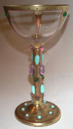 A Jewelled 'Byzantine' goblet, by Carl George Von Reichenbach, for Poschinger, Oberweilslau, Munich, c.1906, the body colour of amethyst richly jewelled with faux turquoise and gem stones of green and amethyst, intersperced with fine gilded scrolls, 6in (15cm) approx