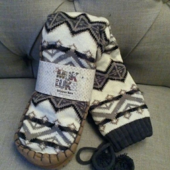 Muk Luks Slipper Socks s/m new These are brand new in the package Muk Luks slippers. They are size small/medium fitting shoe size 5-7.  These are white, grey, black, and tan. 100% acrylic knit.  Open to offers. But no trades. Thanks! :) muk luks Accessories Hosiery & Socks