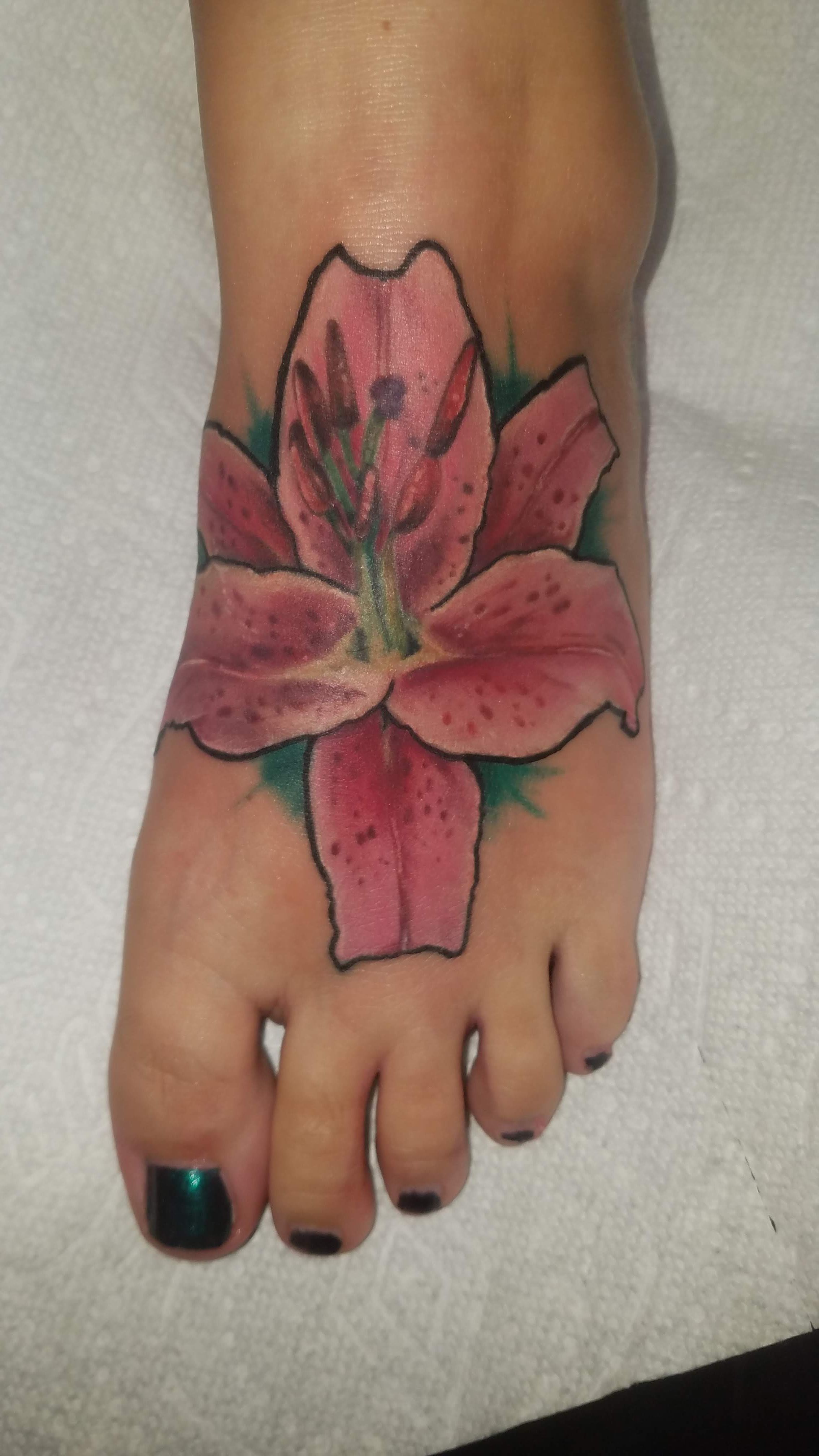 Colorful lily tattoo done by tattoo