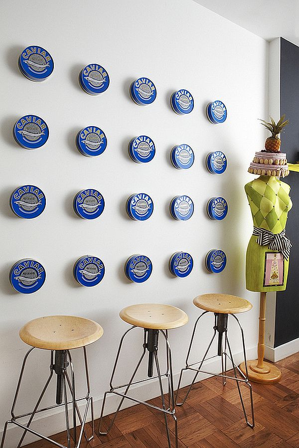 20 caviar cans spaced evenly on a kitchen wall take on an abstract ...