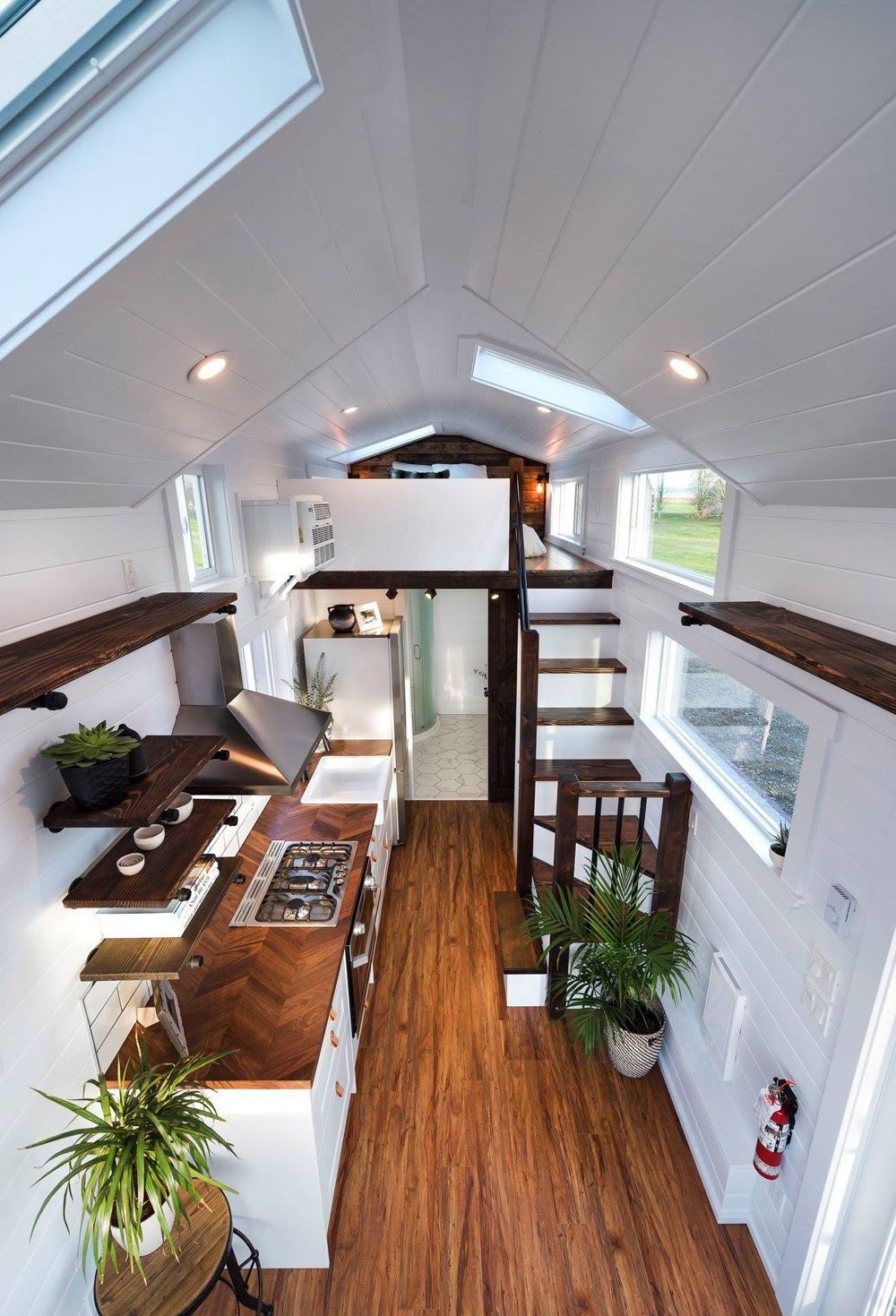 Inside the custom napa edition are white walls ceiling and cabinetry rich wood also beautiful view of rodanthe  ft tiny house on wheels by modern rh pinterest