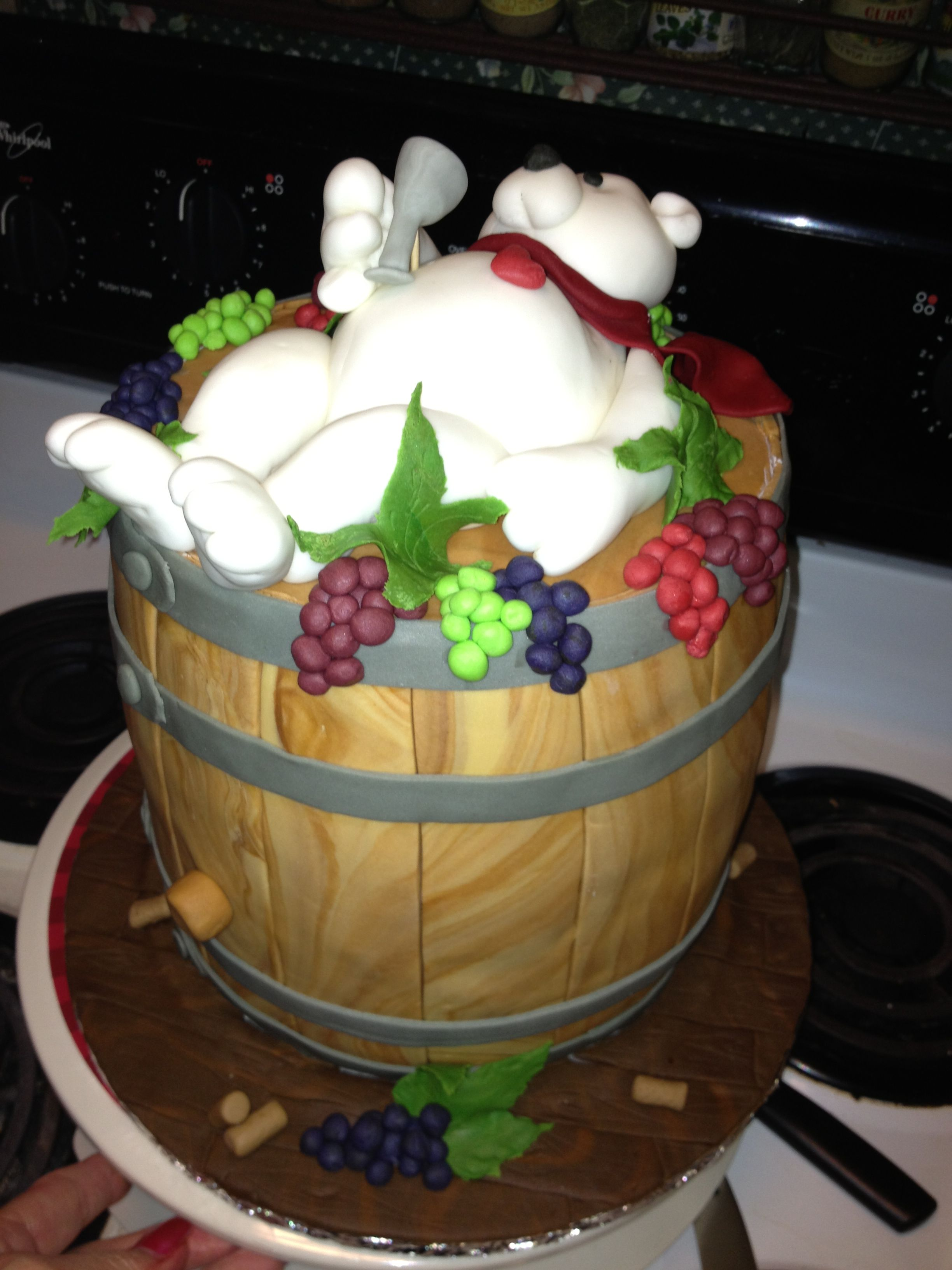I made this cake for a table at the special Olympics! Wine barrel cake with bear!