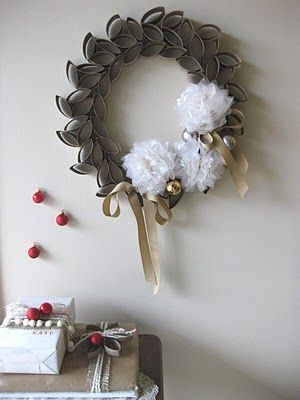 Toilet Paper Roll Wreath by Jamie at See You There.  A take off on a piece featured at Design Sponge.  I really like this!
