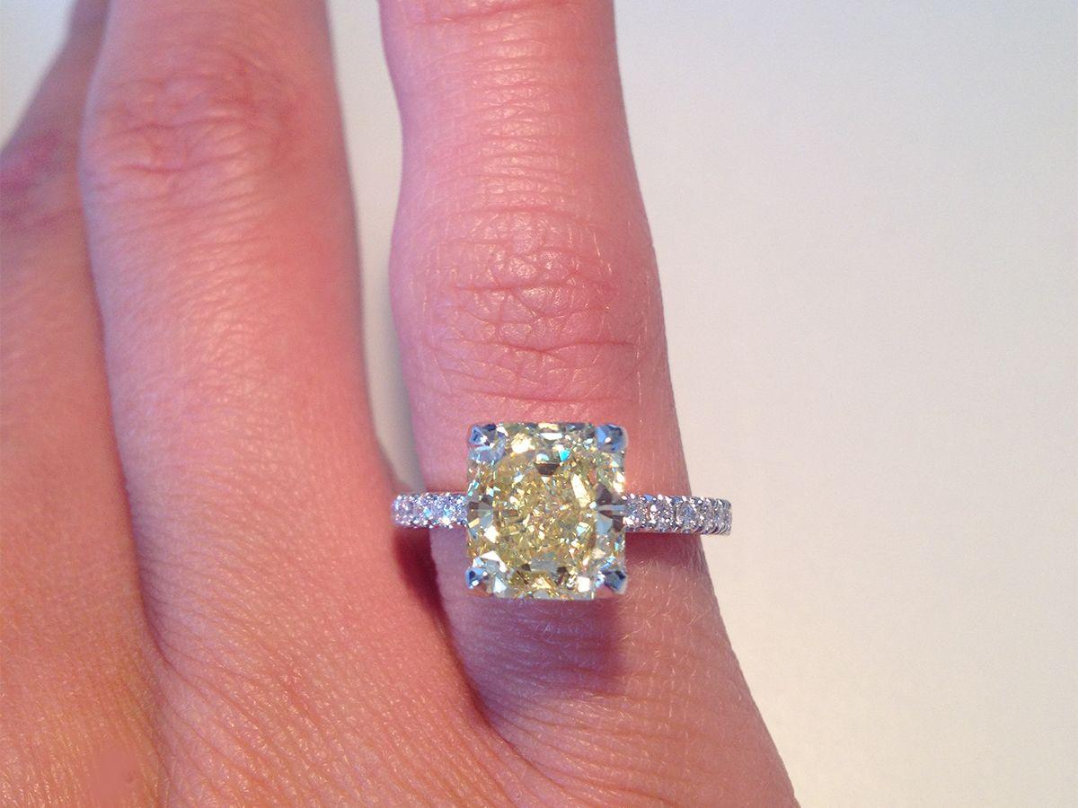 Fancy intense yellow cushion diamond ring with side diamonds ...