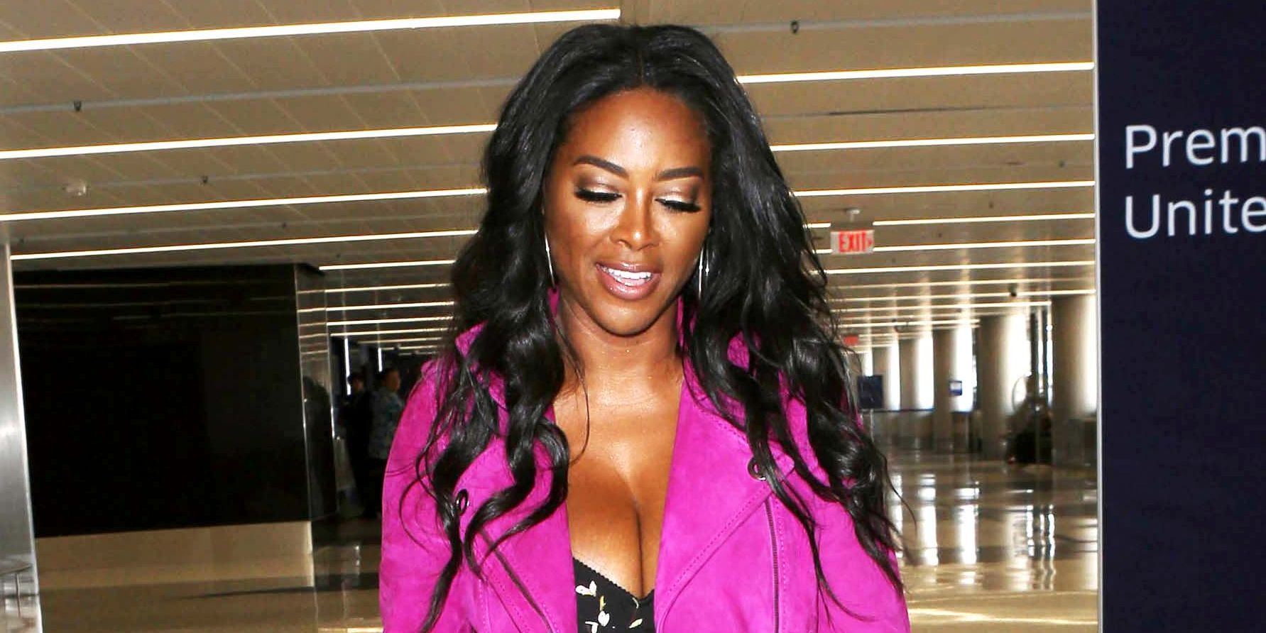 Check Out Kenya Moore & Her Husband Marc Daly On An Outing