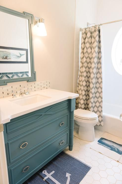 Modern Cottage Kid S Bathroom Boasts Walls Painted Tan Benjamin Moore Sea Salt Lined With B Painting Bathroom Cabinets Peach Bathroom Bathroom Vanity Remodel