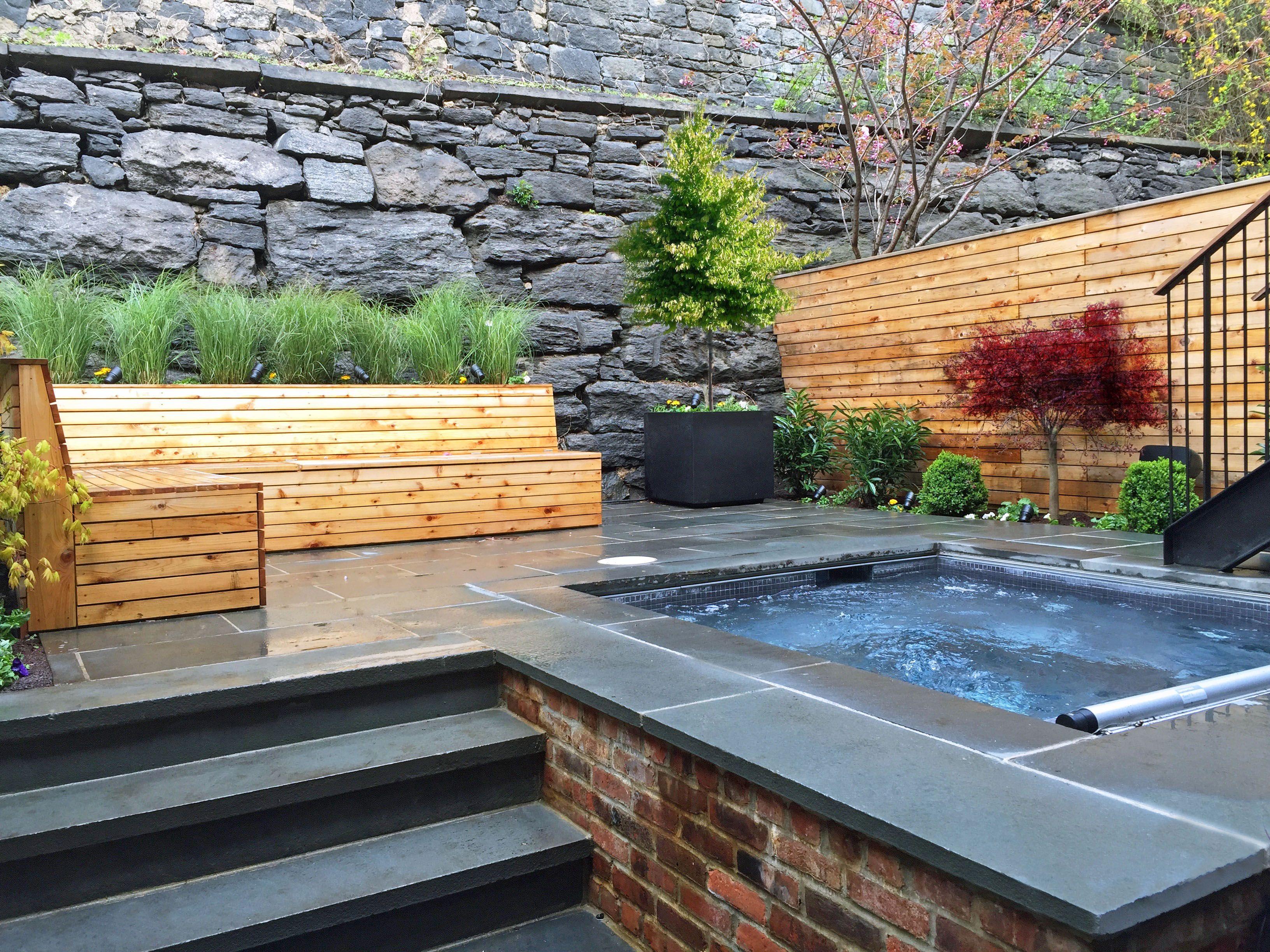 this brooklyn backyard features a bluestone patio horizontal