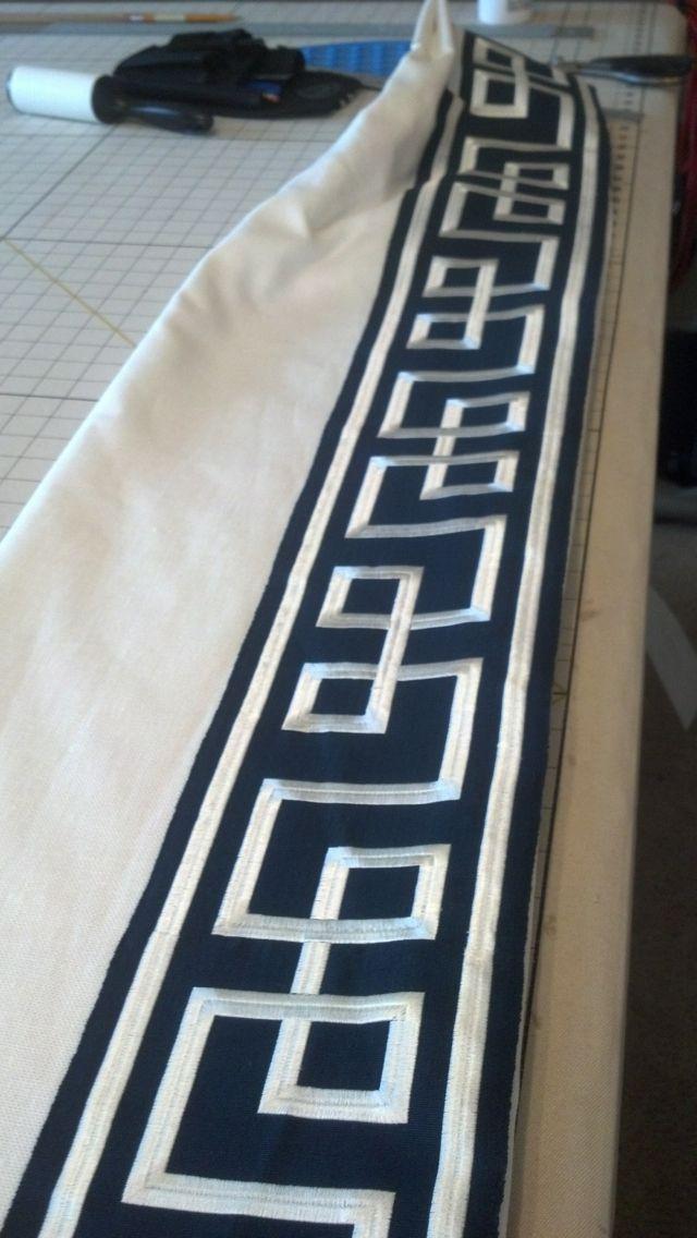Greek key banding on lead edge of drapery panel