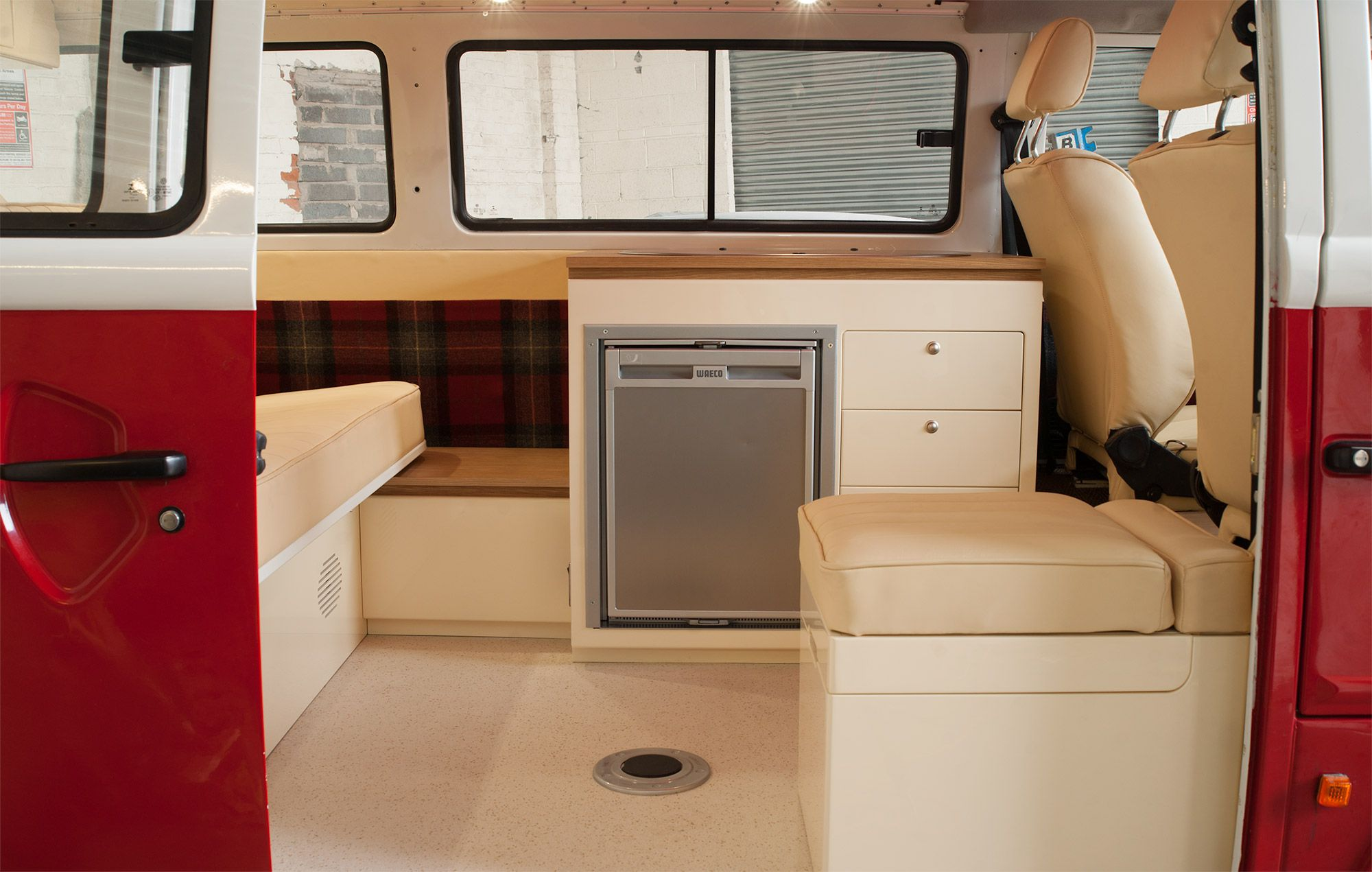 Custom interior full refit for a VW Brazilian Kombi T2, including rock 'n' roll bed, insulation, full leather upholstery and cooking pod