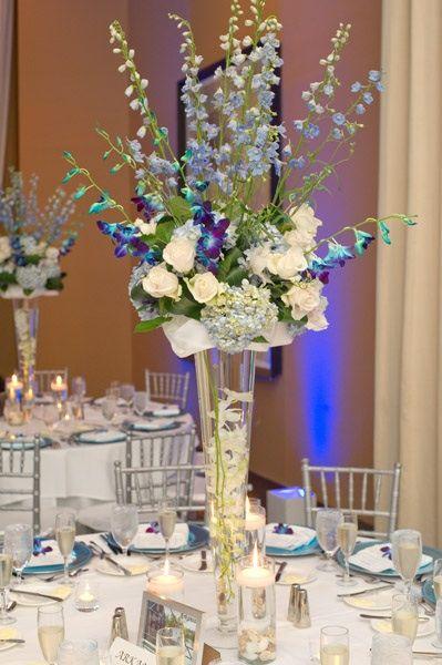 Centerpiece tall pilsner vase with blue dendrobium stems