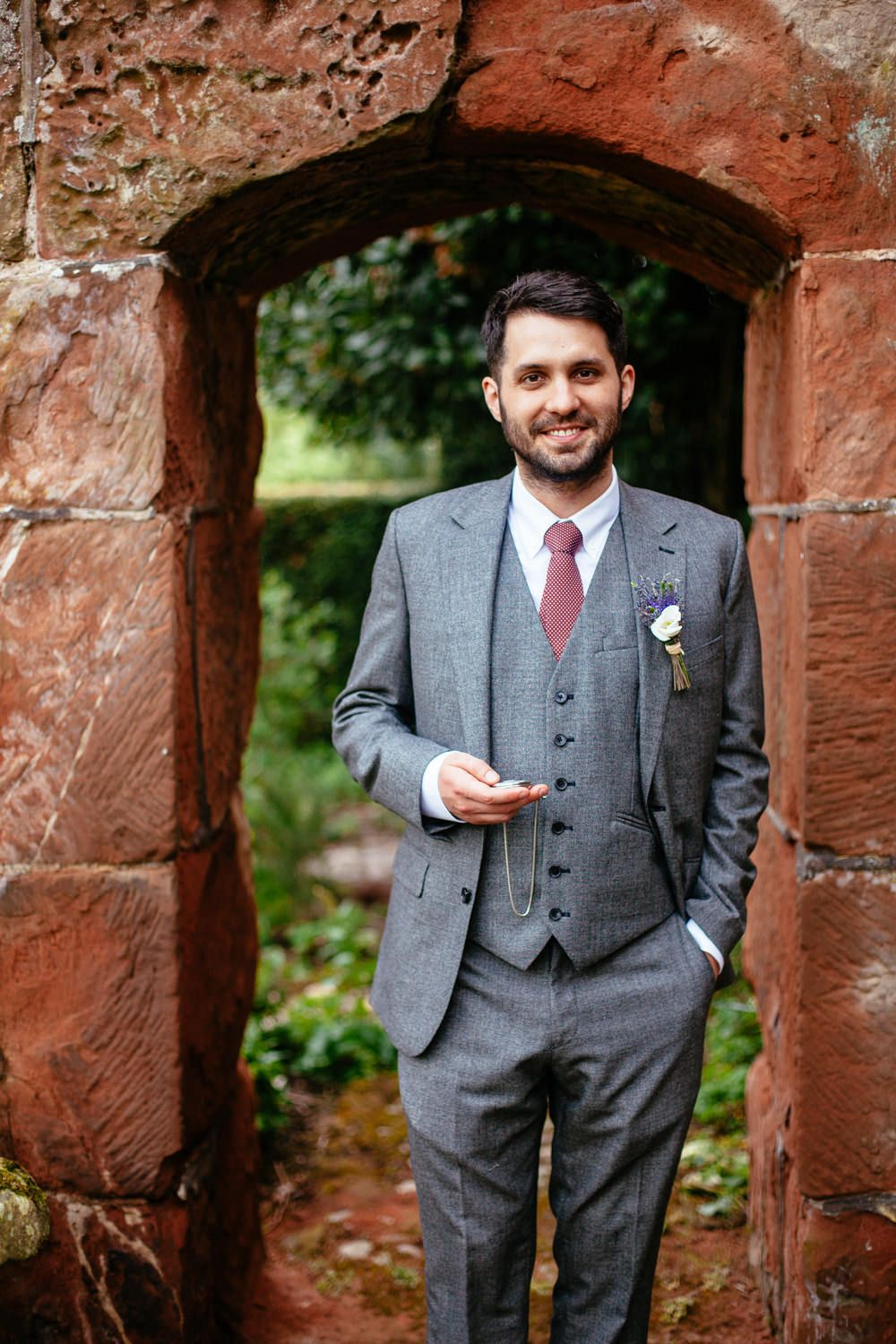 Groom wears a grey suit from Reiss & has pocket watch as gift from bride -   Image by Cassandra Lane Photography - A Charlie Brear lace and silk dress for a west midlands vintage DIY barn wedding with a blue colour scheme and photography by Cassandra Lane