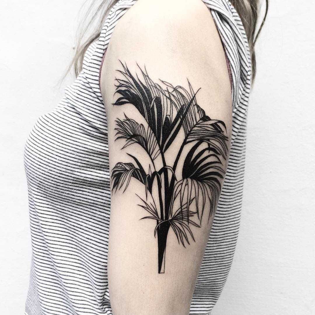 Black branches tattooed on the left arm tattoos tattoo