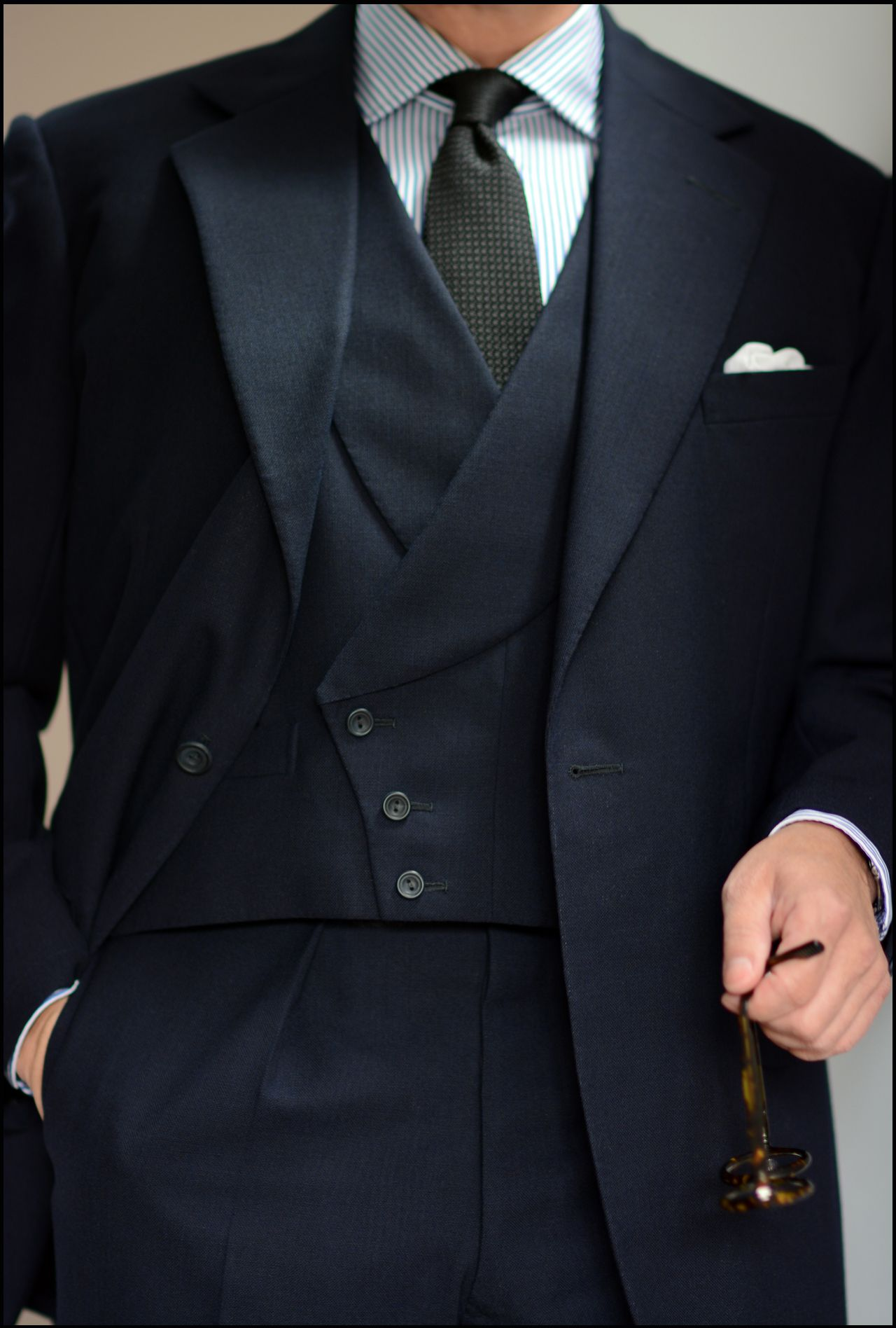 A transitional-season travel-friendly suit made by Edwin DeBoise ...
