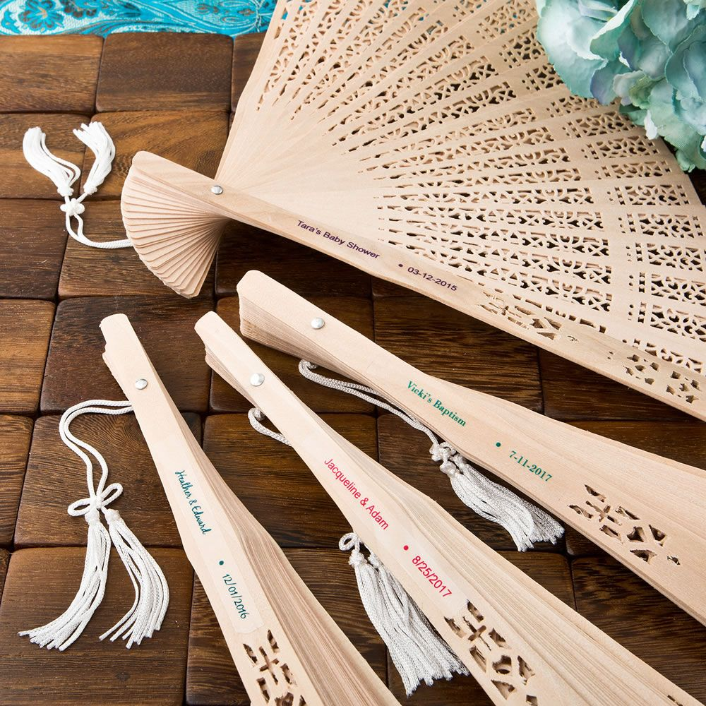 intricately carved sandalwood fan favors from best wedding