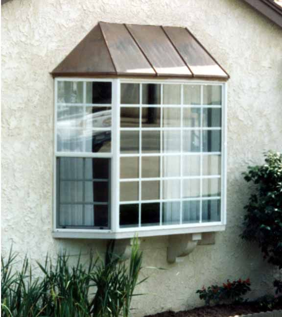 copper roofing over bay windows | This was a old flat wood ...