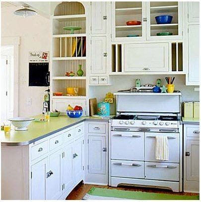 Vintage kitchen: a colorful countertop and a sprinkling of 1930s & 40s pottery add cheer to every kitchen. White is a great background to show off the variety of colors.