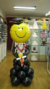 Graduation balloon column Nice the big yellow smiley face blush