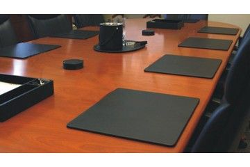Leather desk blotters protect your conference room table from hot laptops and aggressive pens.