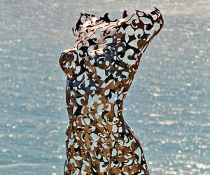The figure is life-size and made of welded steel that's recycled scrap from a laser cutter.
