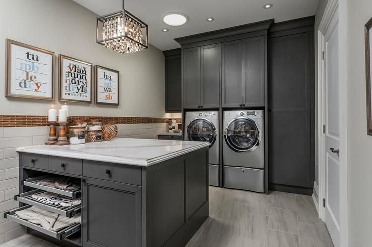 Charming Gray Laundry Room Boasts A Gray Front Loading Washer And