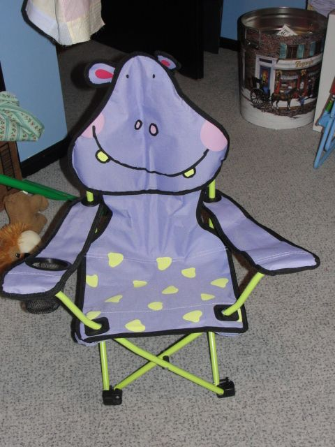 This is the most adorable little folding chair. My grandson loves it  likes to wrap up in his soft blankie  sit in his chair. It has a cup holder which he uses sometimes for his cup but usually it has Handy Manny Tools or Color Wonder Markers in it. I found this at Ace Hardware.
