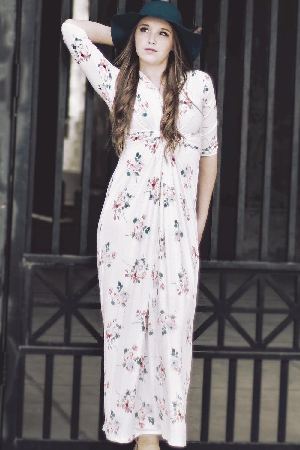 This White Floral Maxi Dress is an elegant classy on trend look. This maxi dress features an all over floral print, 3/4 sleeves, a slip lining underneath and accented with a front tie gathering. We wo