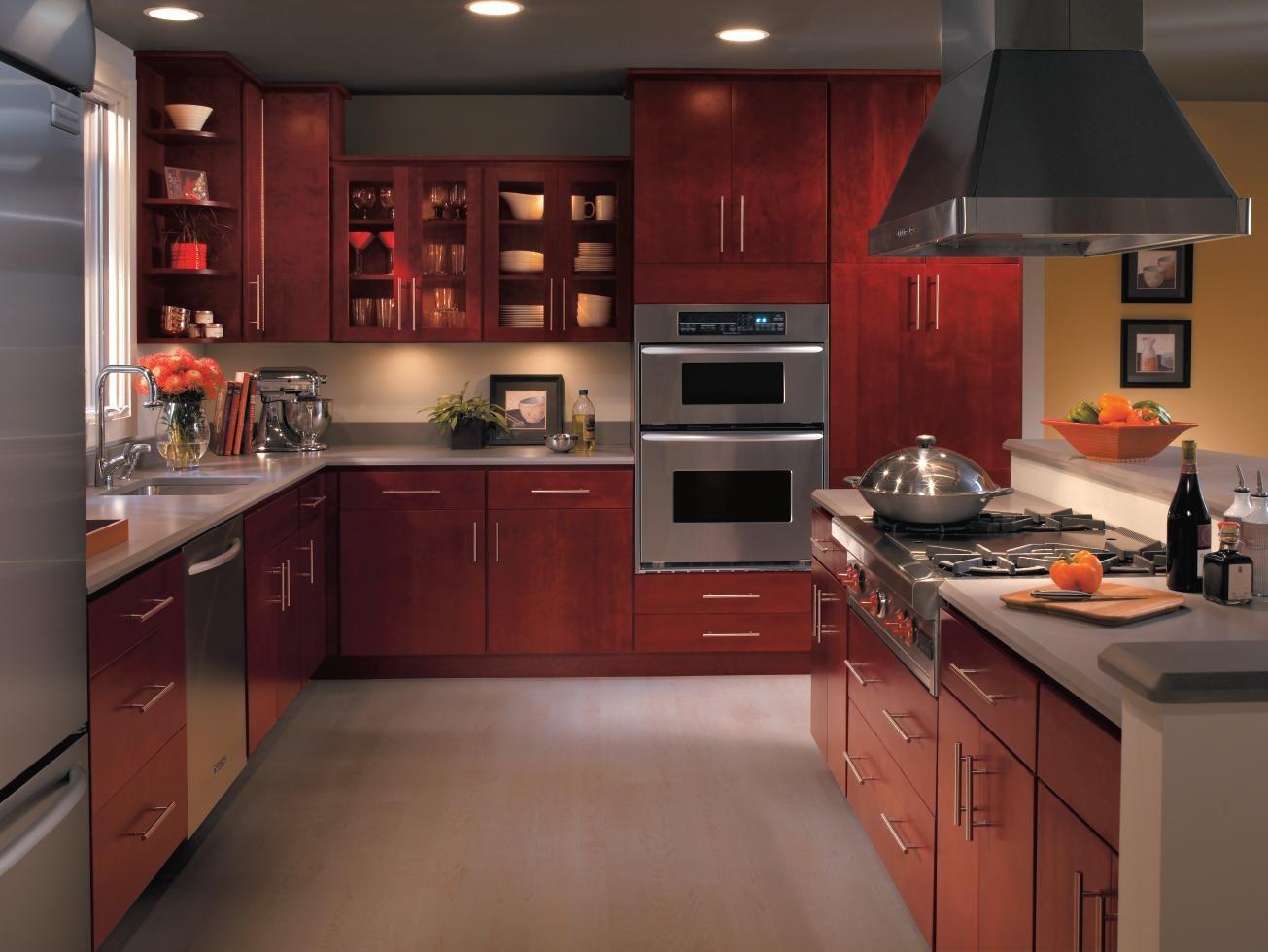 The Beautiful Burgundy Finish On Homecrest S Rainier Cabinets Have Us In A Festive Spirit Enjoy The Ho Cherry Cabinets Kitchen Kitchen Design Kitchen Cabinets