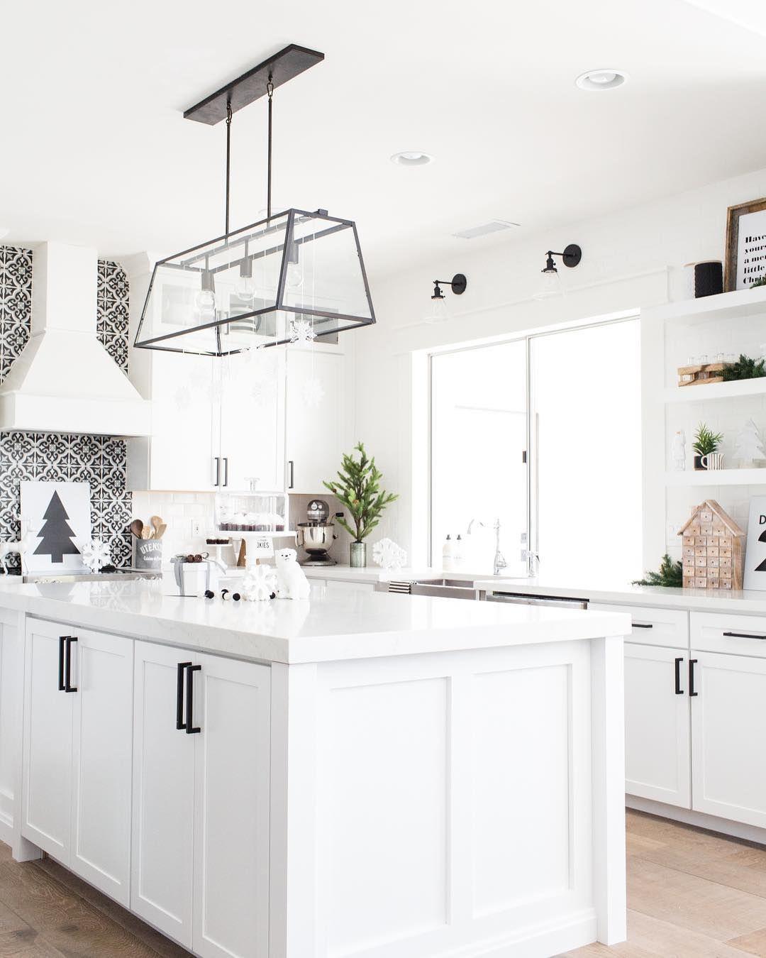 Modern white kitchen with black graphic backsplash and