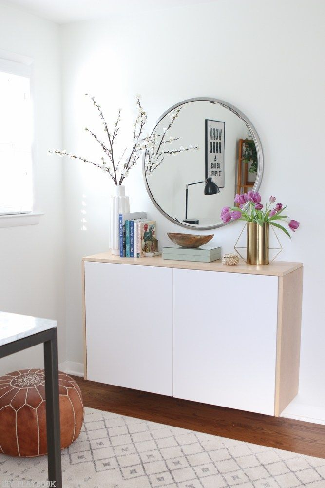 Attractive Love The Styling On This Floating Credenza. A Round Mirror Paired With  Pretty Vases, Bowls, And Some Books. A Simple Look For Your Home Decor.