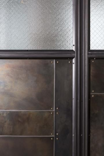 Detail of blackened steel patchwork and wire glass panel | coffee ...