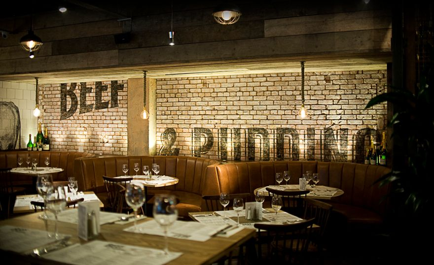 beef pudding is a quirky rustic venue designed by accented by white kitchen tiles and tan leather combining contemporary design and raw materials