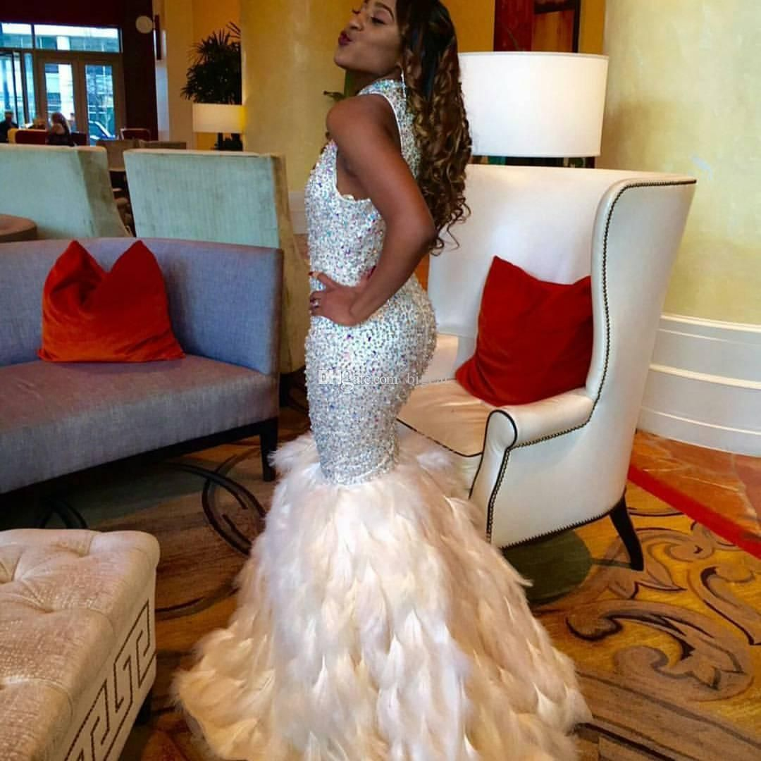 Prepare the dresses for the upcoming prom? Then you need to see high collar beaded ivory mermaid prom dress with feather details in bigear and other prom dresses and popular prom dresses on DHgate.com.