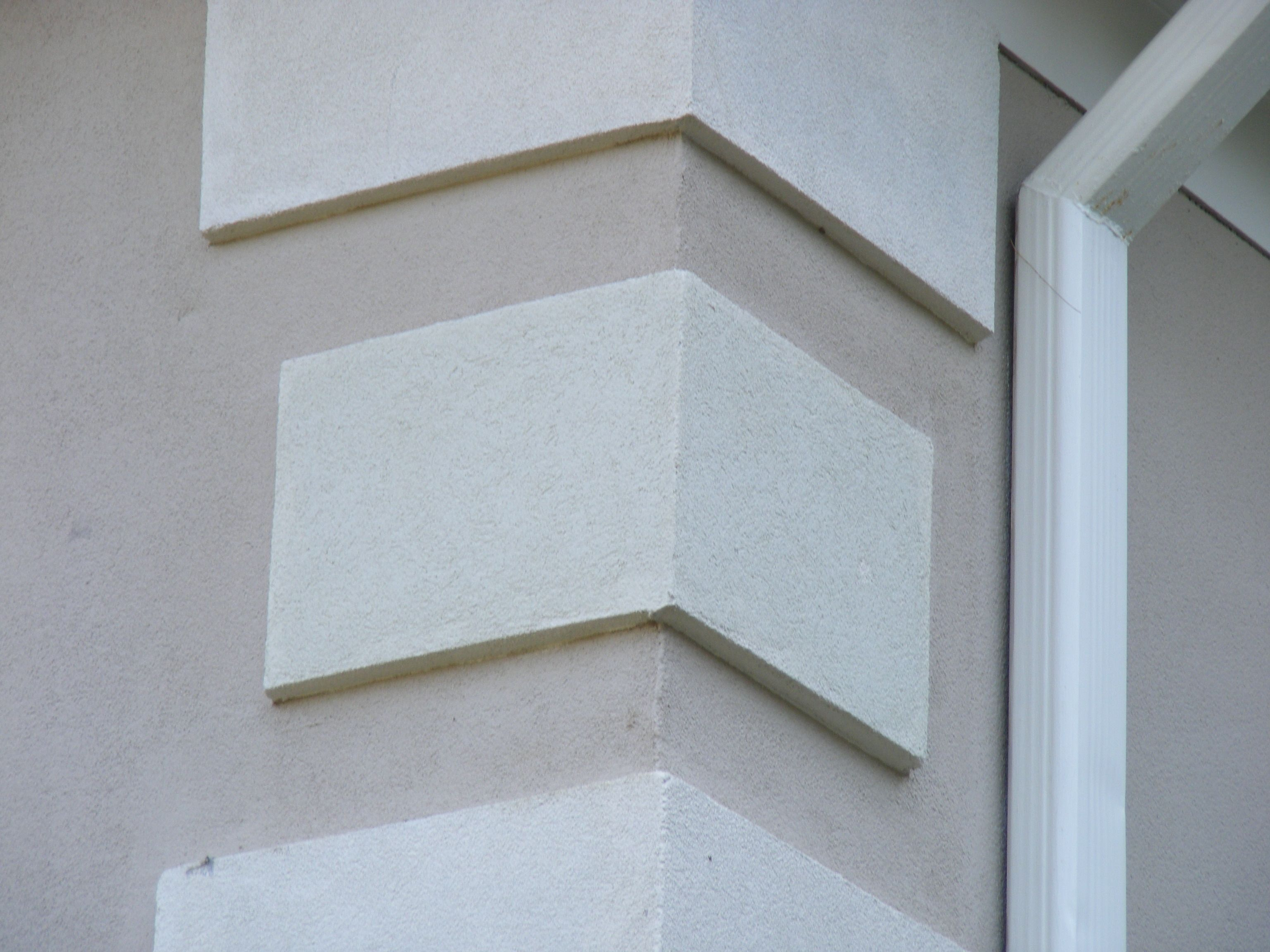 Quoins pronounced coins are often found on the corners Exterior wall plaster design