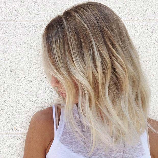 Frosty Blonde Highlights This look is a twist on the classic