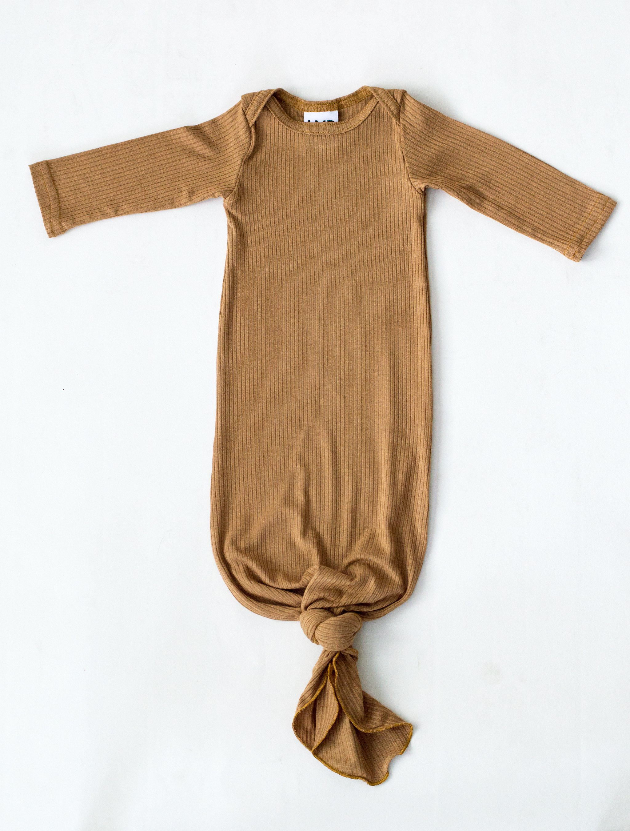 f36c553aa Our Little Nursling™ snuggle knotted baby gowns are the perfect outfit to  bring your newborn home in. A modern take on the classic lap neck onesie,  ...