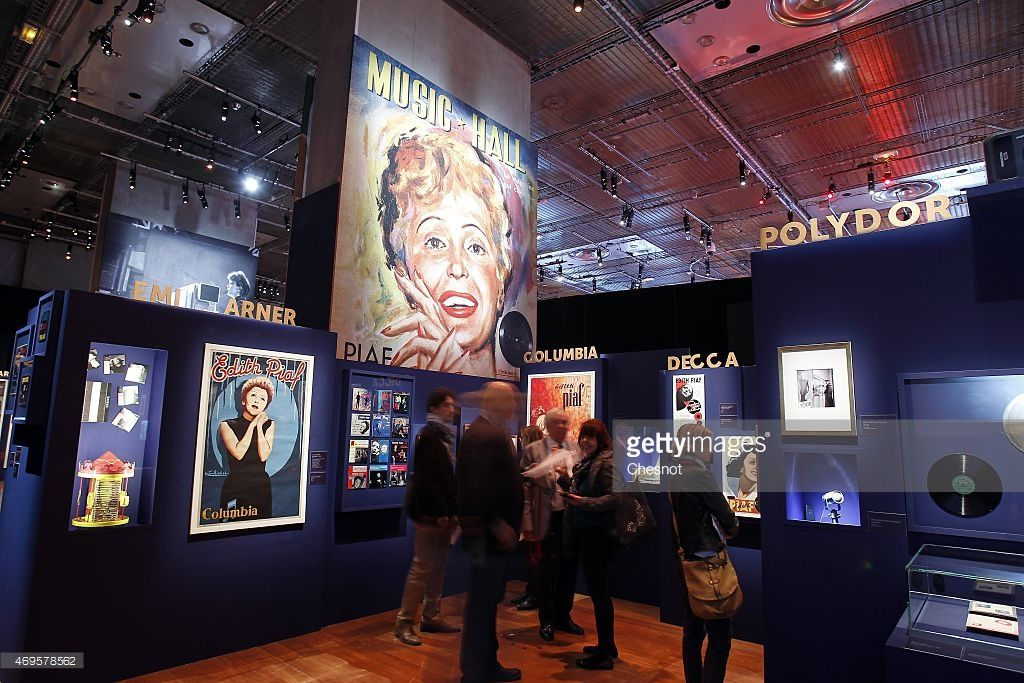 Visitors look at pictures and posters of the french singer Edith Piaf displayed…