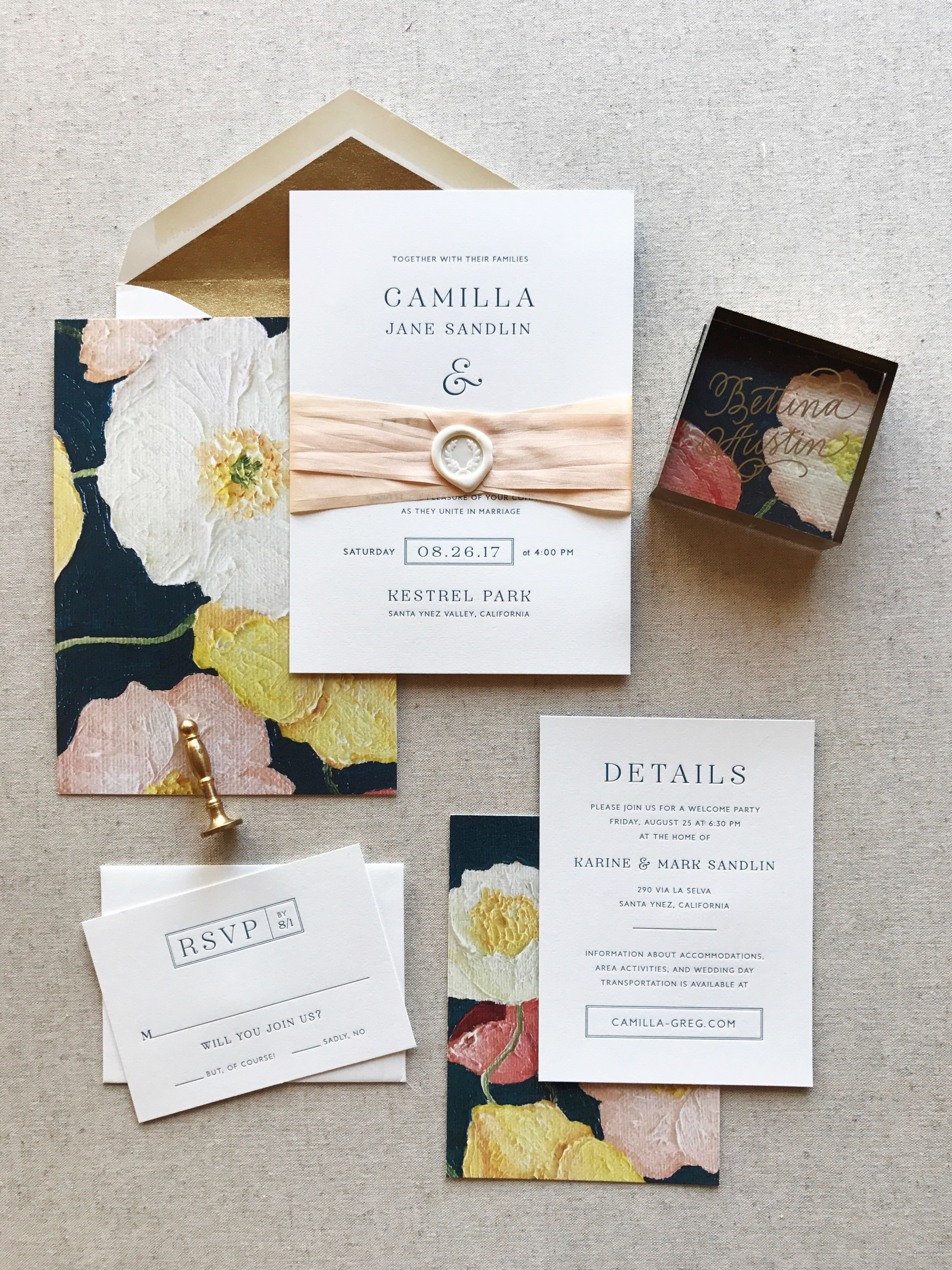A letterpress wedding invitation with a custom oil painting of ...