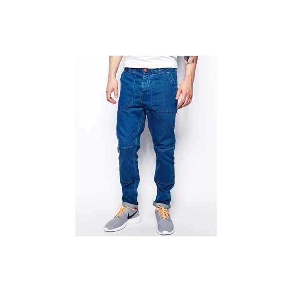 ASOS Tapered Jeans With Skater Design Detail ($26) ❤ liked on Polyvore featuring men's fashion, men's clothing, men's jeans, mens tapered jeans, mens button fly jeans and asos mens jeans