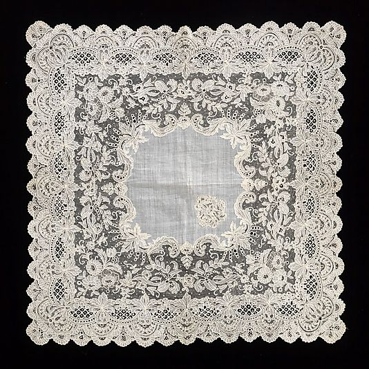 "Handkerchief. ""This complex and attractive combination of styles exemplifies the high-quality Belgian lace of the late 19th century"". Date: third quarter 19th century Culture: French Medium: cotton, linen Dimensions: 16 x 16 in. (40.6 x 40.6 cm)"