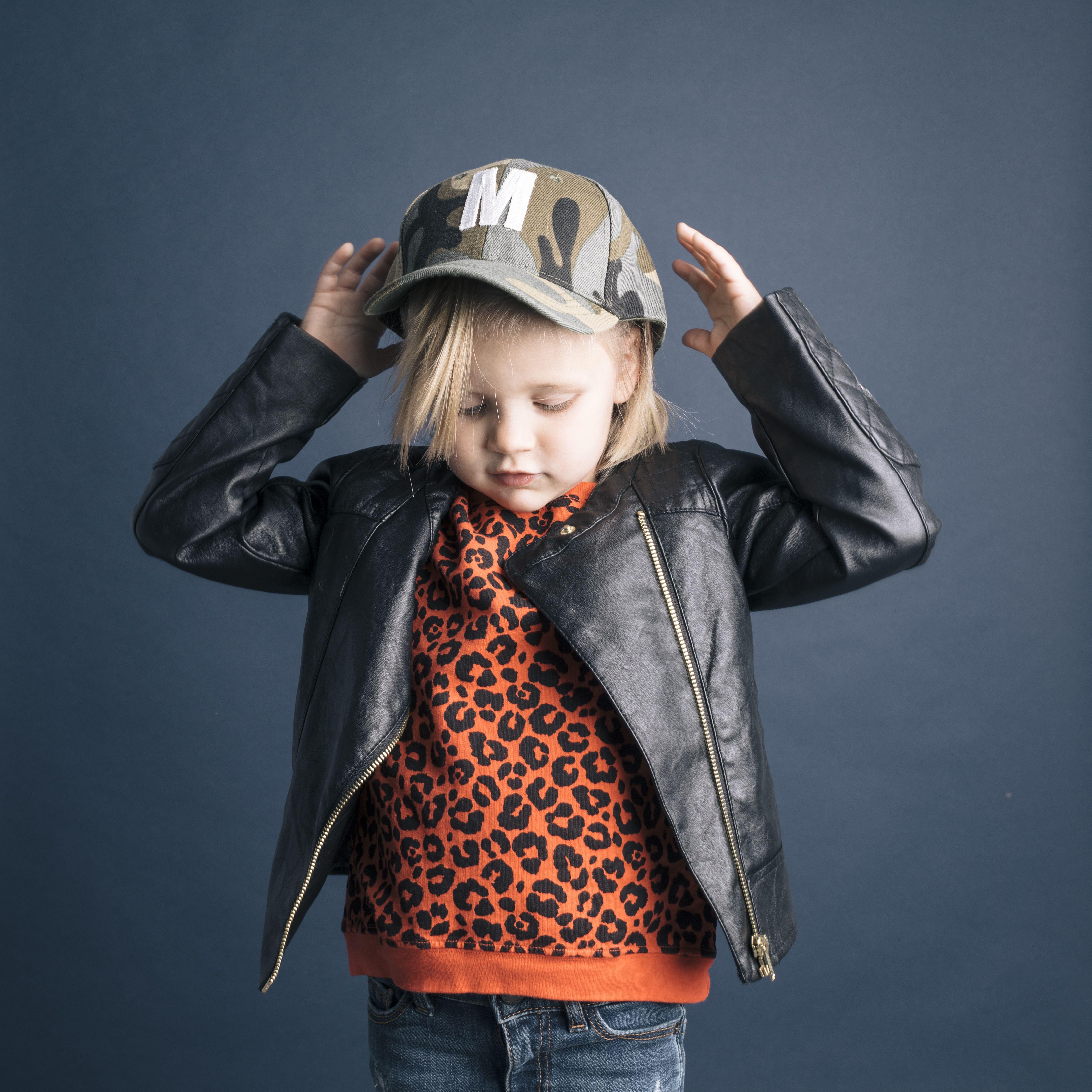 Orange Cheetah Print Sweatshirt Paird With A Black Leather Jacket And A Camp Hat Cheetah Print Sweatshirt Embellished Denim Toddler Fashion [ 4458 x 4458 Pixel ]
