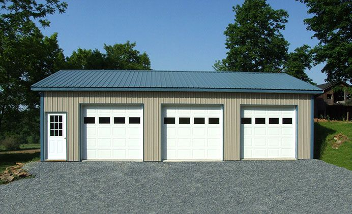 3 Car Garage With Center Door 22114sl: This Three Car Garage Could Be Yours!!! Dimensions: 24' W