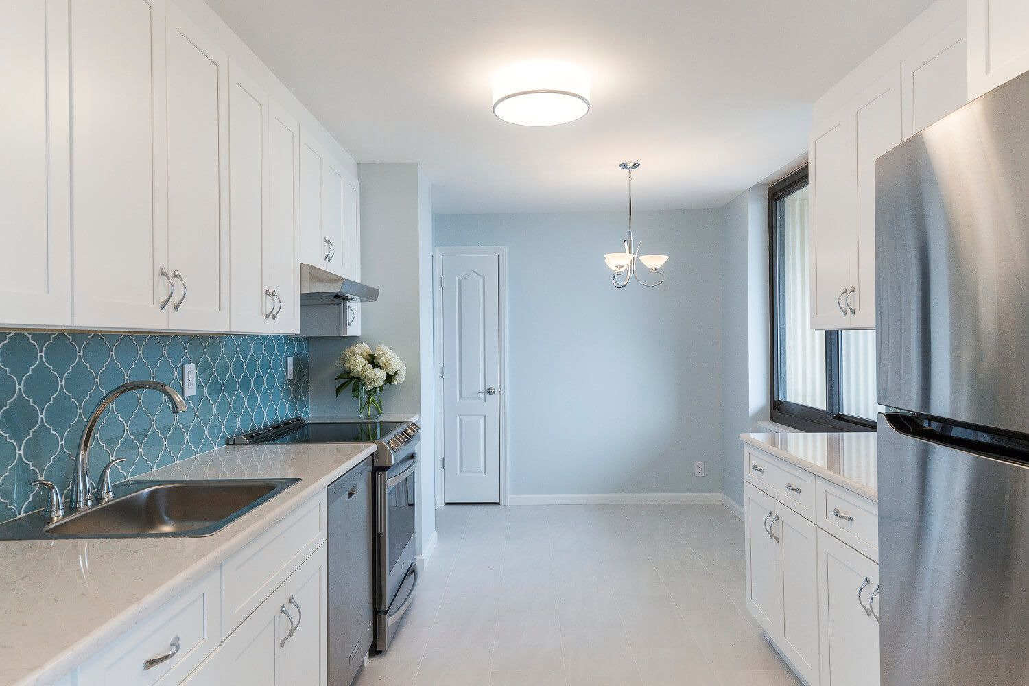 White shaker kitchen + glass arabesque backsplash tile. Interior ...