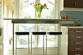 working a kitchen around low windows - Google Search #cuisinedintérieurcontemporain