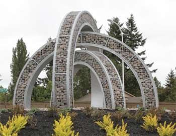 Metal and rock sculpture by Josh Wiener at a roundabout in Happy Valley, Penn.
