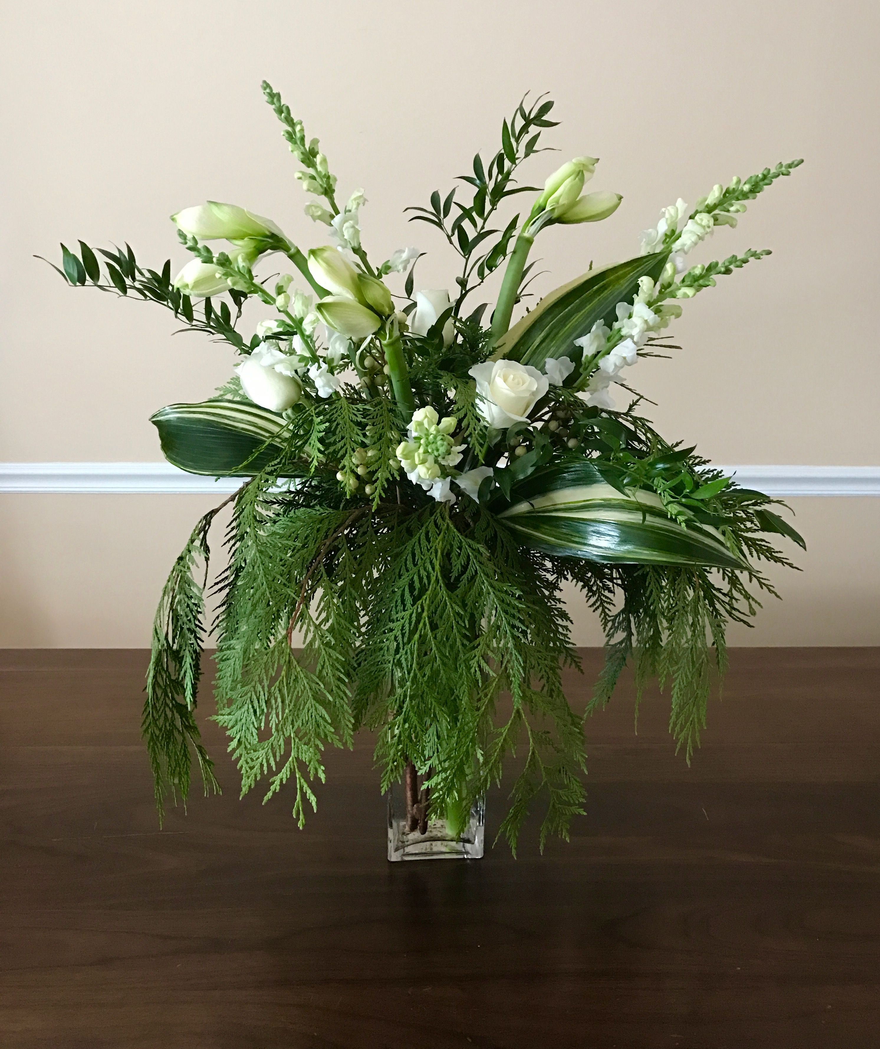 Tall Flower Arrangement In White And Green Color Tones Winter Greens Variegate Fresh Flowers Arrangements Tall Flower Arrangements Purple Flower Arrangements