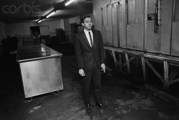 """June 13, 1968 - Vincent Thomas DiPierre, stands to the left of the spot (shown as the light or bleached area by DiPierre's feet), where Senator Robert Kennedy was shot in the Ambassador Hotel kitchen.  DiPierre, told a grand jury that Sirhan had a """"sick looking smile on his face"""" and that a girl in a polka dot dress was standing next to him when the shots were fired."""