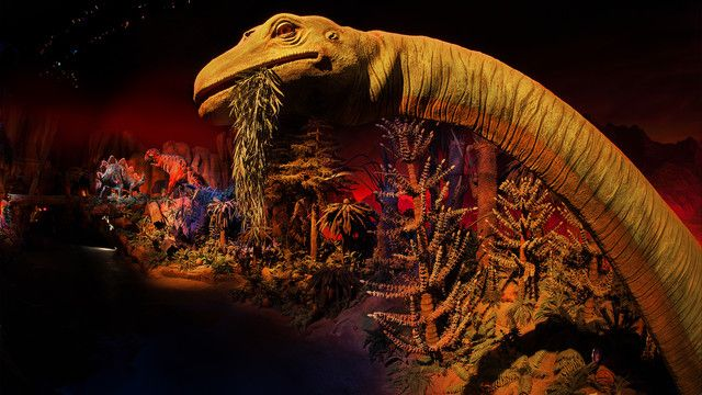 A brontosaurus chews leaves in a prehistoric scene at Ellen's Energy Adventure at Epcot